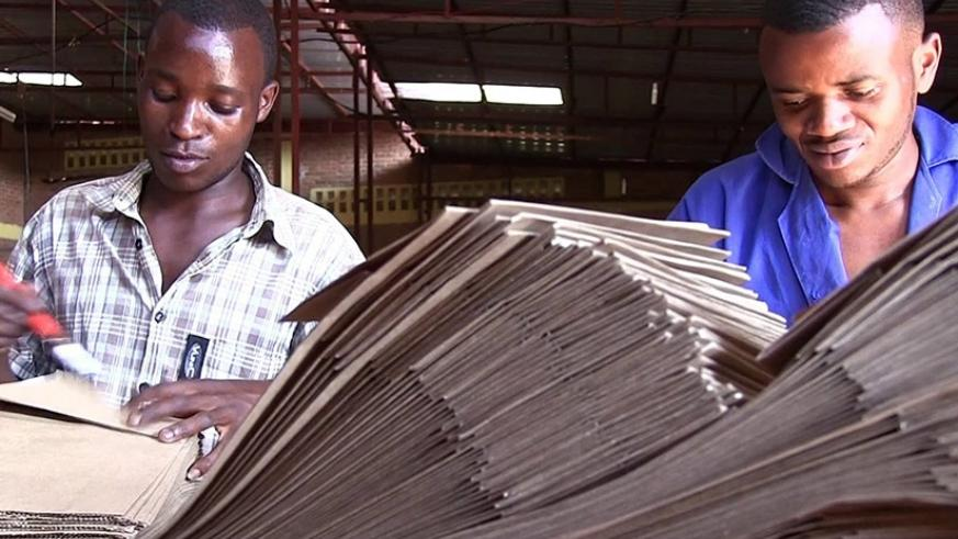 Youth engaged in making paper bags in Kigali. Other countries in the region have joined the efforts of using bio-degradable paper instead of plastic bags. File