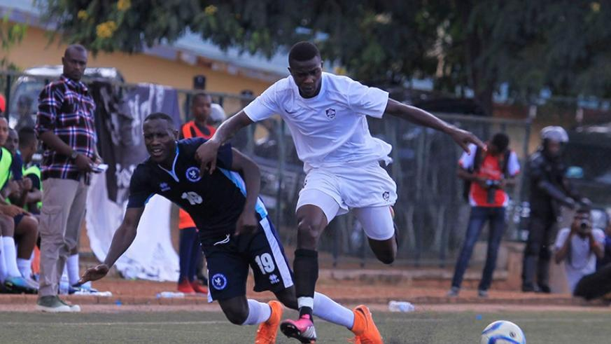 APR FC winger Emmanuel Imanishimwe dribbles past a Police FC defender last season. The Army side team will face the Law enforcers on Wednesday. (S. Ngendahimana)