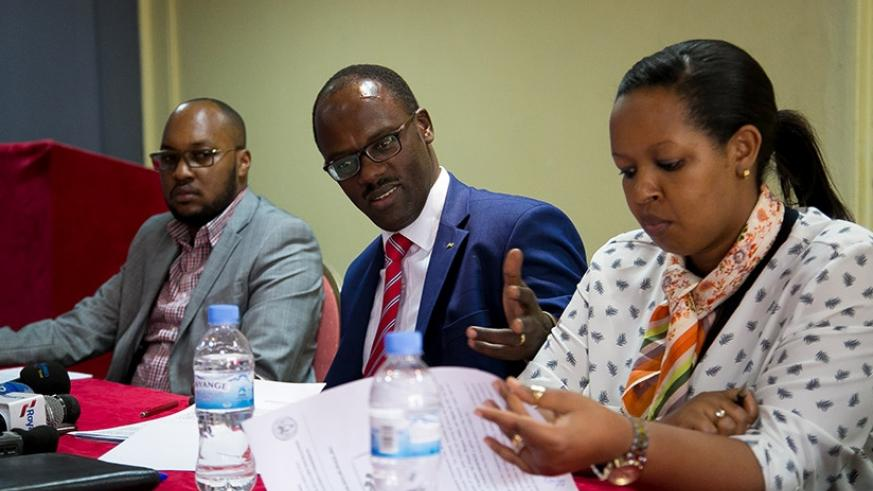 Ndayisaba (C) addresses the media on Thursday as Never Again 's Dr Joseph Nkurunziza (L) and Laetitia Umutirabura, from the Ministry of Gender and Family Promotion, look on. Fausti....