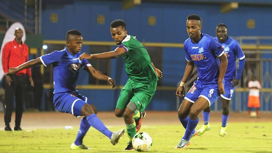 AS Kigali new signing Dominique Nshuti Savio (centre) faced his former team Rayon Sports for the first time. Sam Ngendahimana.