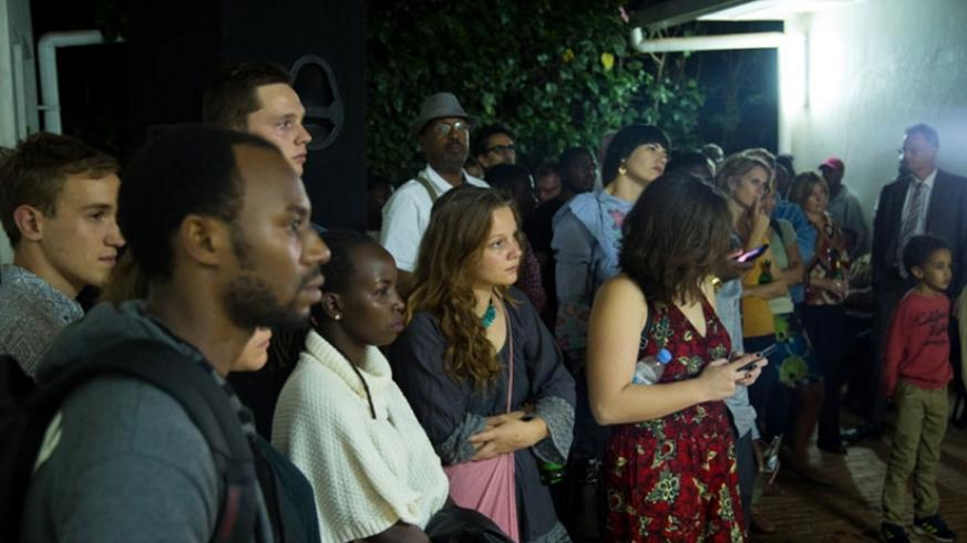 Guests listen to Shaban Masengesho's presentation during his photo exhibition at Goethe-Institut on Friday. All photos by Timothy Kisambira.
