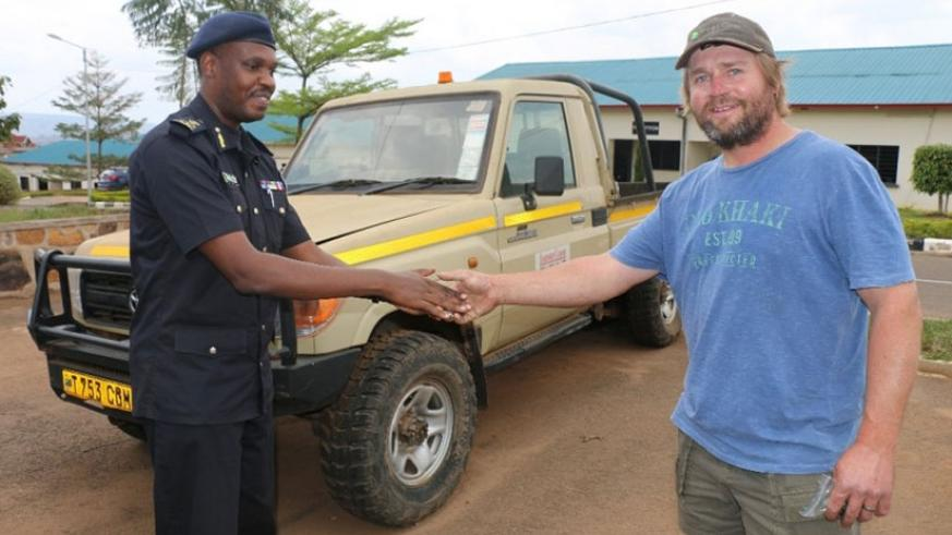 South African national Bernard Kobus receives the keys to his truck that he lost five over years ago. Three stolen vehicles were returned to South African owners by Rwanda National....