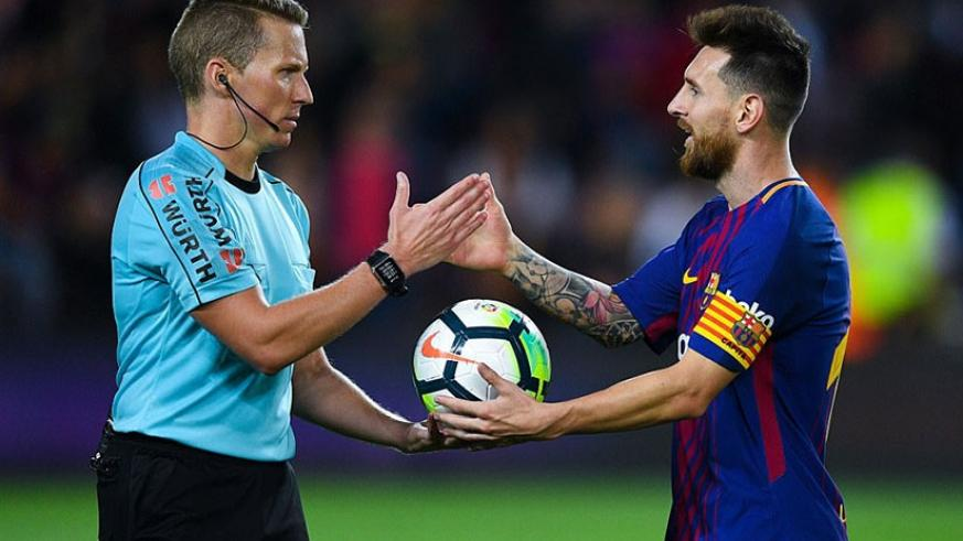 Messi collects the match ball from referee Alejandro Jose Hernandez following Barcelona's 6-1 victory over Eibar. Net photo