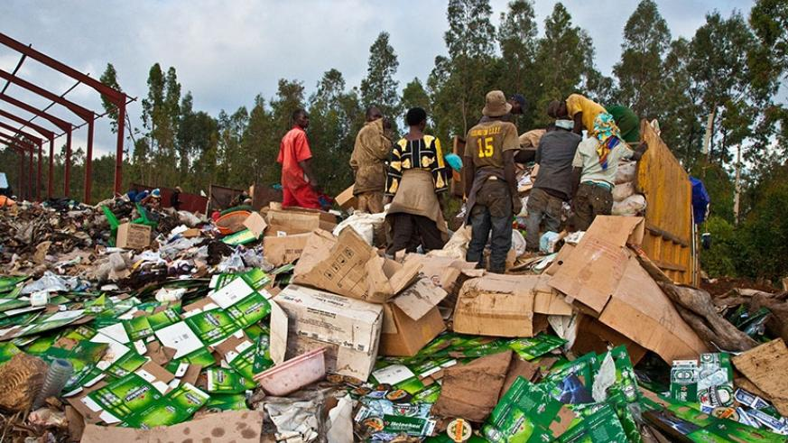 Workers  at Nduba dump site in Gasabo District sort out gabbage. Timothy Kisambira.