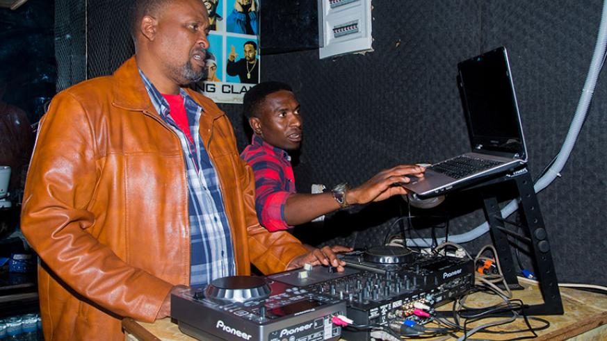 Cobra with one of his DJs inside the club. / Faustin Niyigena