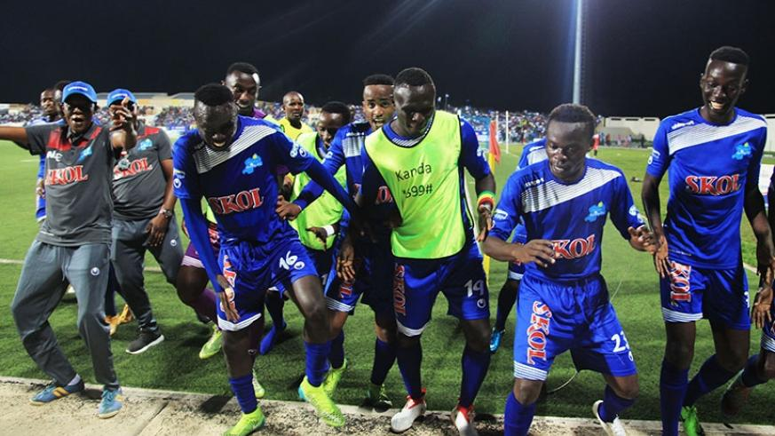 Midfielder Pierrot Kwizera (2nd from right) is joined by his Rayon Sports teammates to celebrate the second goal against APR FC at Umuganda Stadium on Saturday. Sam Ngendahimana