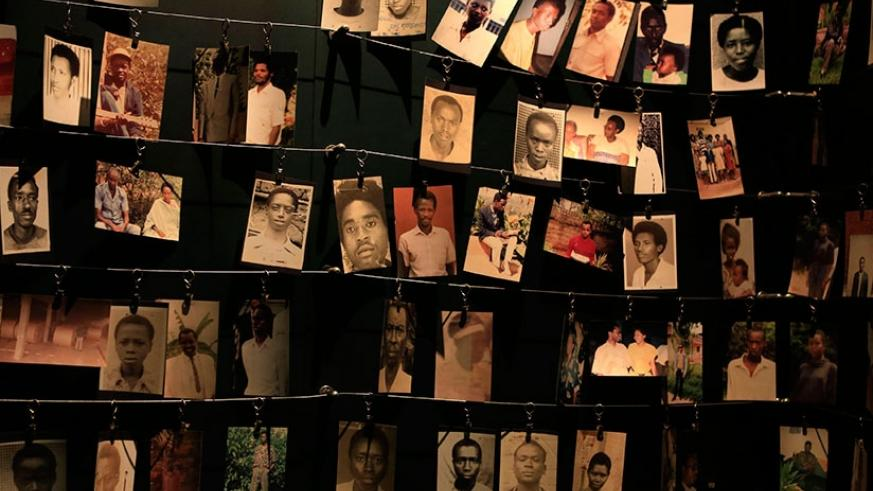 Family photos of victims of the 1994 Genocide against the Tutsi hang inside the Kigali Genocide Memorial.  Net photo
