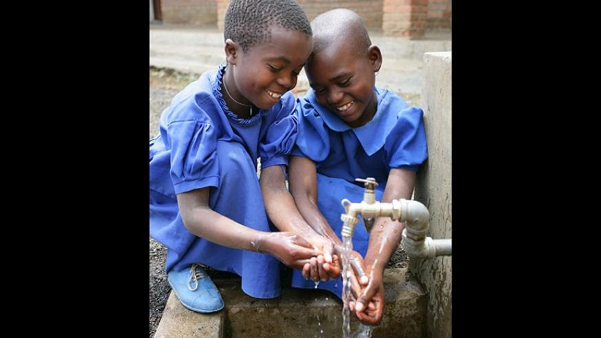 Children washing hands. Clean water is an important part of life. Clean water keeps our bodies healthy. What can you do to help keep water clean?  (©UNICEF Rwanda/2013/Pirozzi)