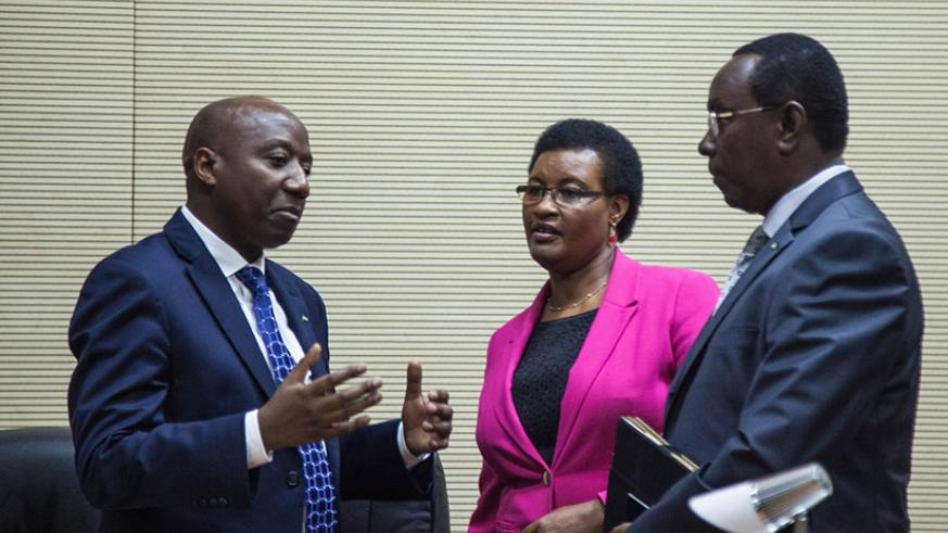 Prime Minister Edouard Ngirente (L) chats with Speaker of the Chamber of Deputies Donatille Mukabalisa (C) and Senate president Bernard Makuza after presentation of the Government'....
