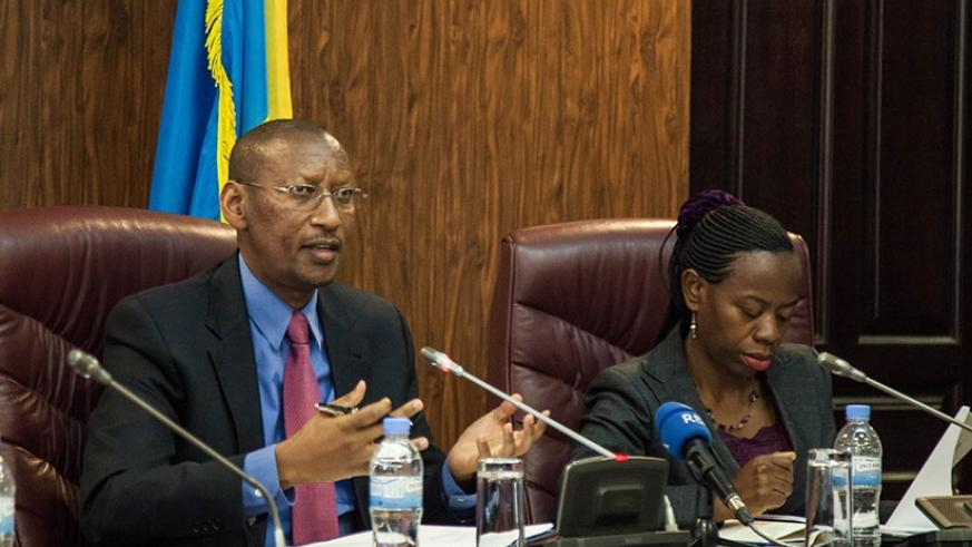 National Bank of Rwanda governor John Rwangombwa speaks during the Financial Stability Committee meeting in Kigali yesterday as Vice-Governor Monique Nsanzabaganwa listens. (Nadege Imbabazi)