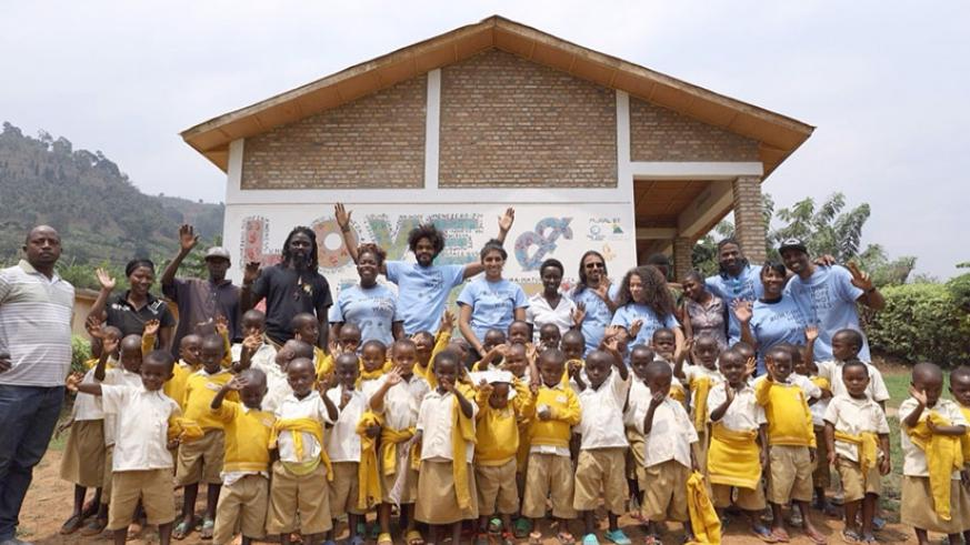 Kigali and Chicago artists pose for the photo with school children in Rwesero, Northern Province. / All pictures courtesy of Cam Be.