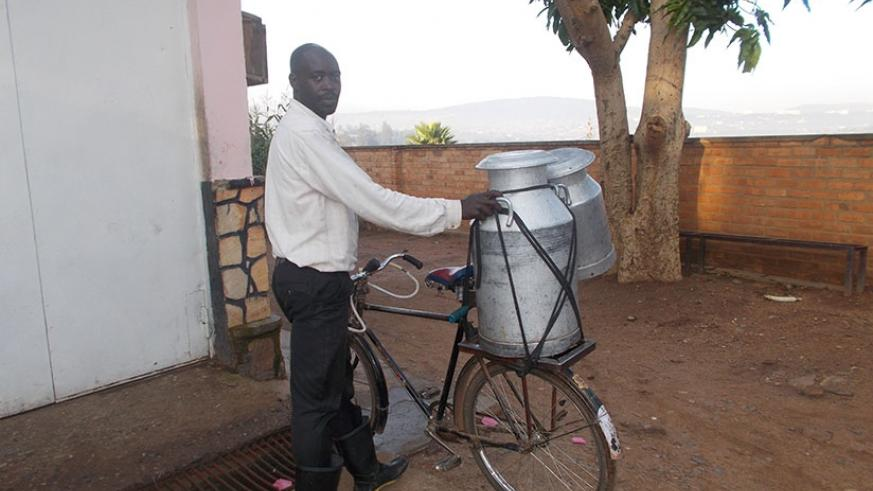 A man delivers milk at a collection centre in Kigali. Rwanda seeks to promote trade in processed milk to increase stakeholder benefits. / Elias Hakizimana