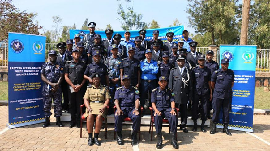 The commandant of PTS, CP Vianney Nshimiyimana, head of EASF Police component ACP Dinah Kyasimire, Chief Supt. Claude Tembo and course participants in a group photo. / Courtesy