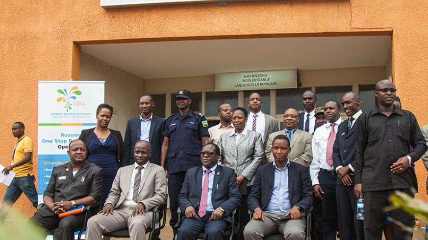 Officials pose for a photo after the launch at Rusumo yesterday. Nadege Imbabazi
