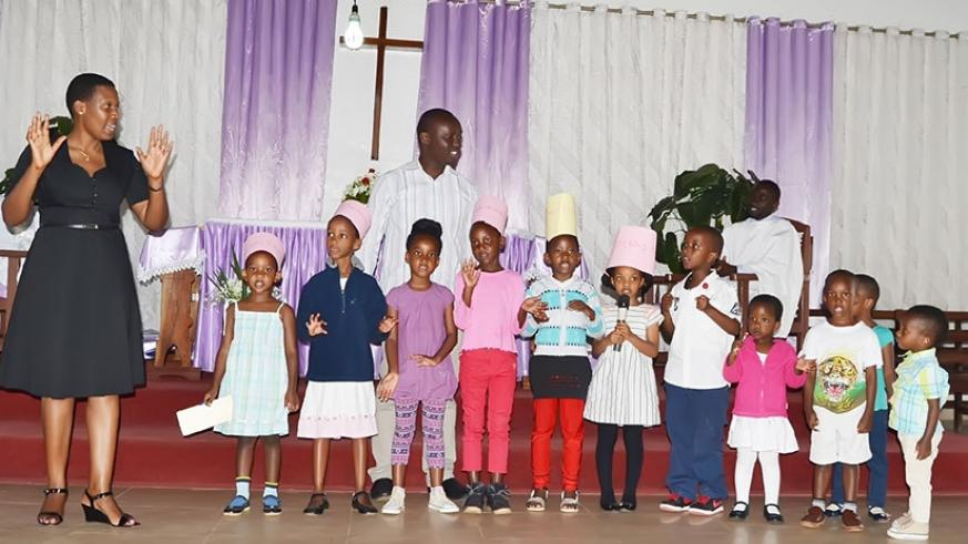 Children singing during Sunday school service. In Sunday schools children learn the value of helping one another.  (Dennis Agaba)
