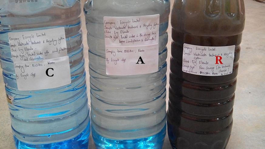 Treatment levels at Ecocycle. The bottle on the right shows raw sewage:  the one in the centre shows water in SRB (Sequential Batch Reactor) after treatment, while the one on the l....
