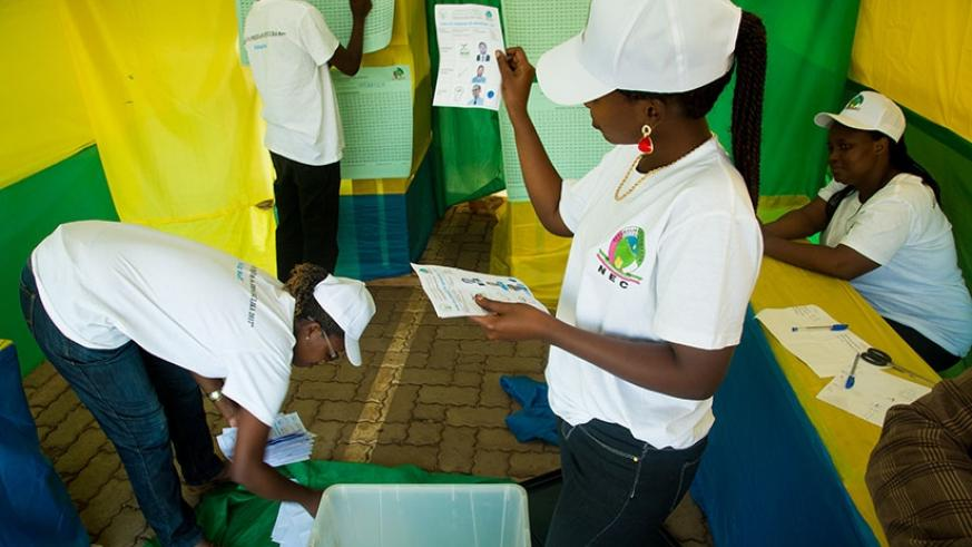 Electoral agents count votes in Remera, Gasabo District during the recent presidential elections. (File)