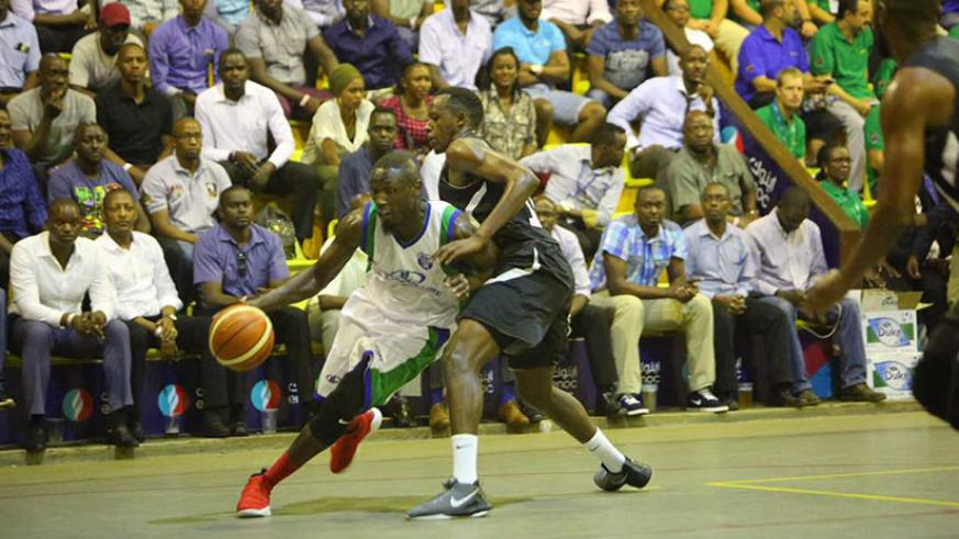 Patriot's Steven Havugintwari tries to block a City Oilers player on Tuesday night at Lugogo Indoor Arena. / Usher Komugisha
