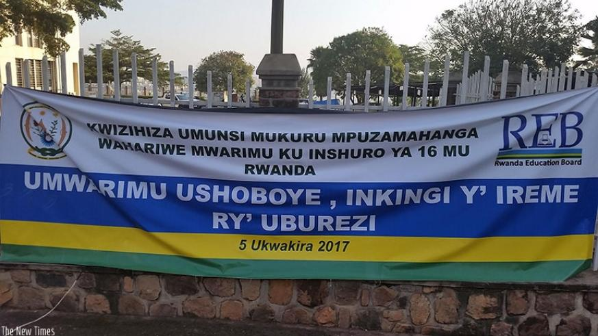A banner that proclaims today's World Teachers' Day on display in Remera, Kigali. Umwalimu-SACCO says it has stepped up efforts to recover bad loans. (Courtesy)