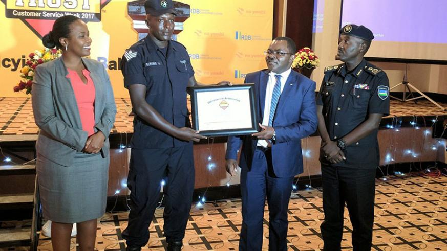 Senior Sergeant Alexis Murenzi who works with the Rwanda National Police's Traffic department receiving an award for the Customer Service Champion 2017. / Courtesy
