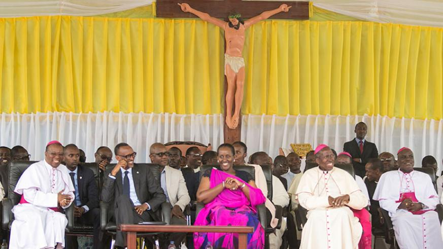 President Kagame and First Lady Jeannette Kagame with Bishop Philipe Rukamba of Butare Diocese (L) and Bishop Smaragde Mbonyintege of Kabgayi Diocese (R) during the centenary anniv....