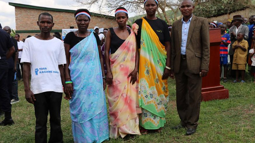 Patrick Bimenyimana extreme with his miracle village committee. / Courtesy