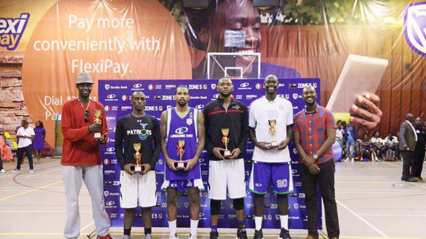 Patriots' Mugabe (2nd left) and Kabange (C) were named on the team of the tournament along with Mayes (Oilers), Stanley Ocitti (Oilers) and Betway Power's Mike Makiadi. Courtesy