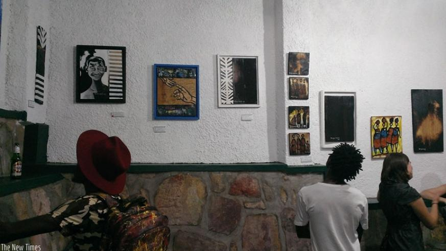 Guests admire  the images on display. ( Photos by Moses Opobo)