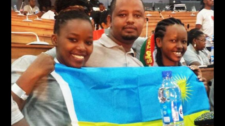 Yvette Ishimwe (right), of Iriba Clean Water Delivery, and other two enterprising Rwandan youth attended last year's forum. (File)