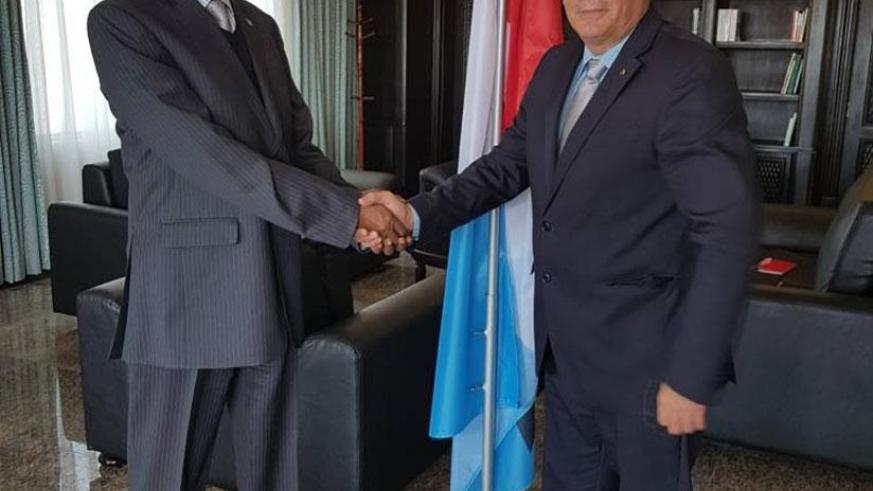 RPF Secretary General Francois Ngarambe and the Cuban envoy, Antonio Luis Pubillones Izaguirre after their meeting in Rusororo yesterday. (Courtesy)