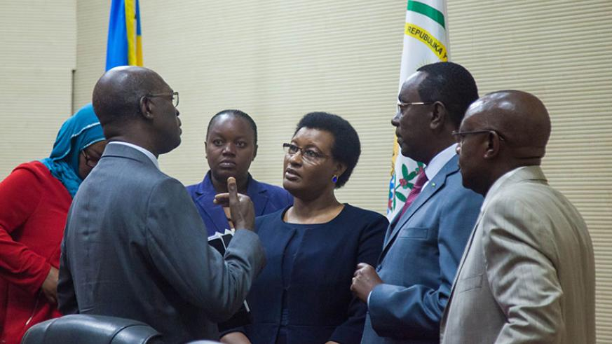 Murekezi (L) and leaders of the Lower House and Senate chat after the meeting at Parliament yesterday. / Nadege Imbabazi