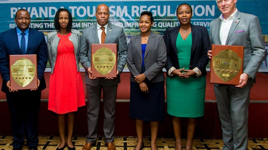A group photo of Youth minister Rosemary Mbabazi (4th from left), Rwanda Development Board chief executive Claire Akamanzi (2nd from right), and RDB chief tourism officer Belise Ka....