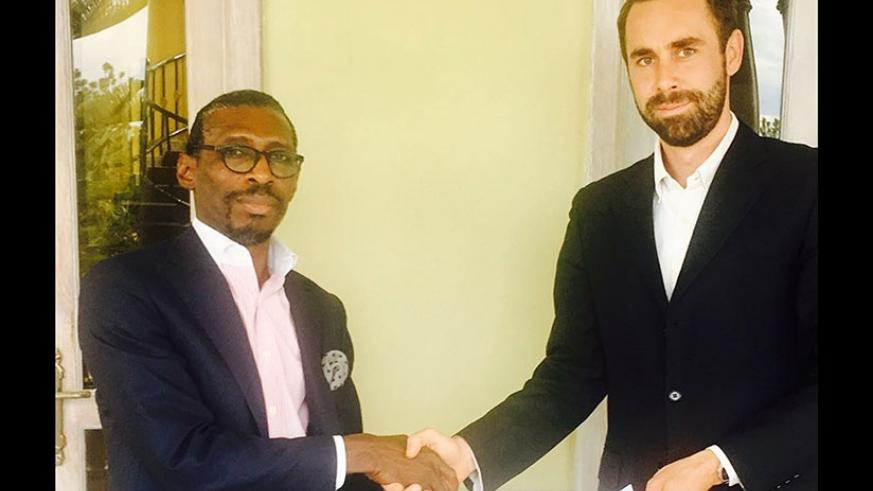 Done deal: Olusegun (left) and Rouviere exchange documents after signing the takeover deal on Friday. BlackPace plans to inject over $10m into Ndiyo to expand capacity.   (Courtesy)
