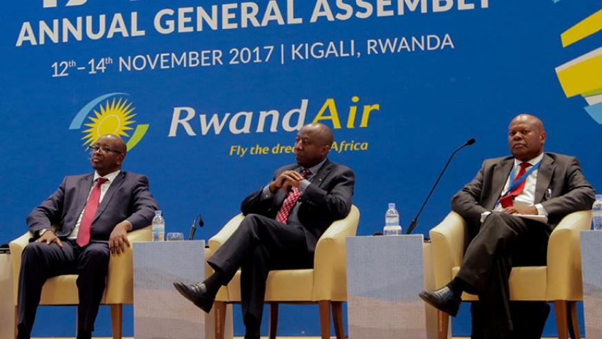 Rwanda's Prime Minister Edouard Ngirente (centre), infrastructure minister James Musoni (left), and Chingosho listen to presentations at AFRAA summit yesterday. / Faustin Niyigena