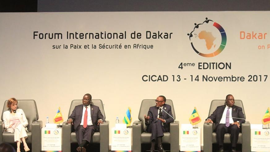 President Kagame speaks at the Fourth edition of the international Forum on Peace and Security in Africa. On the President's left is President Macky Sall of Senegal, while Chadian ....