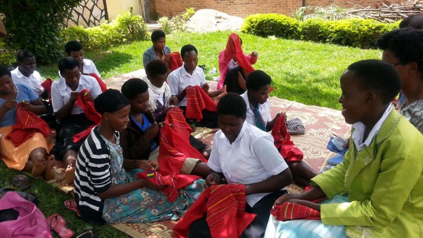 Beneficiaries attending an embroidery class. Courtesy