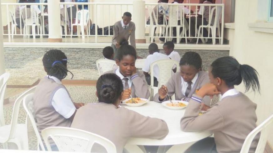 Students share a meal. The boarding school environment  helps students to learn to be independent. (Lydia Atieno)