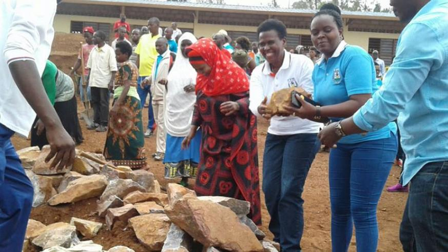 Kicukiro District officials and residents take part in the construction of an ECD centre. (File)