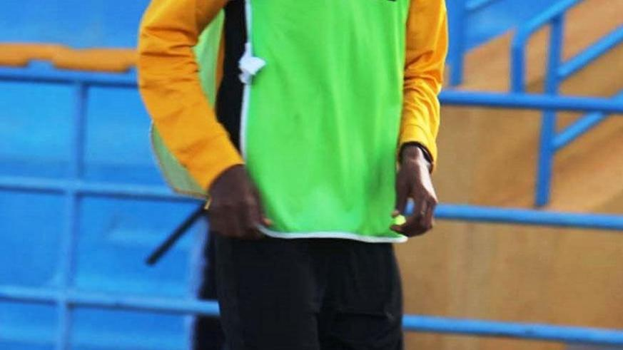 Alex Nkomezi, seen here warming up at Huye Stadium. The attacking midfielder will be out for up to a month with a knee injury. Courtesy