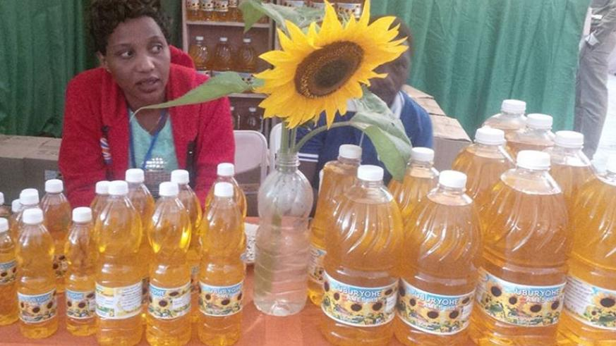 Exhibitors wait for buyers at the just-ended expo. The cooking oil is made by a local firm, Uburyohe Ames, from sunflower.  Ensuring quality and value-addition are essential for SM....