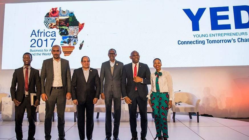 Young Entrepreneurs Day (YED) panelists, from left; YED Ambassadors Jean Bosco Nzeyimana and Mohamed Azab, President Abdel Fattah Al Sisi of Egypt, President Kagame, Nigerian busin....