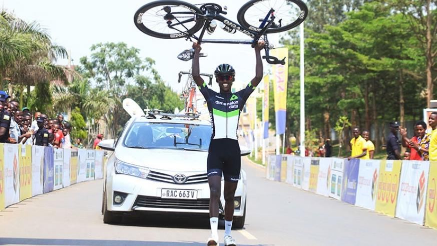Dimension Data rider Samuel Mugisha lifts up his bike to celebrate the solo finish during Rwanda Cycling Cup final day recently. (Sam Ngendahimana)