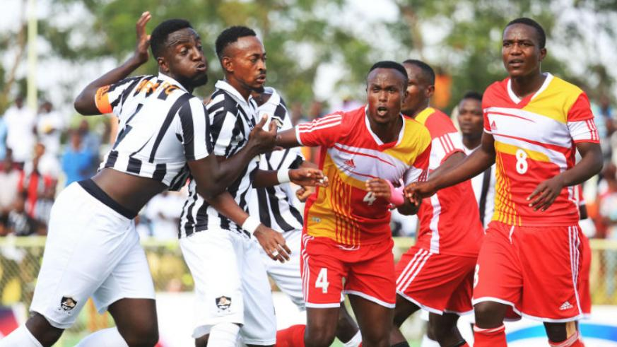 Musanze FC and APR FC players vie for the ball during the recent league match at Kigali Stadium. / Sam Ngendahimana