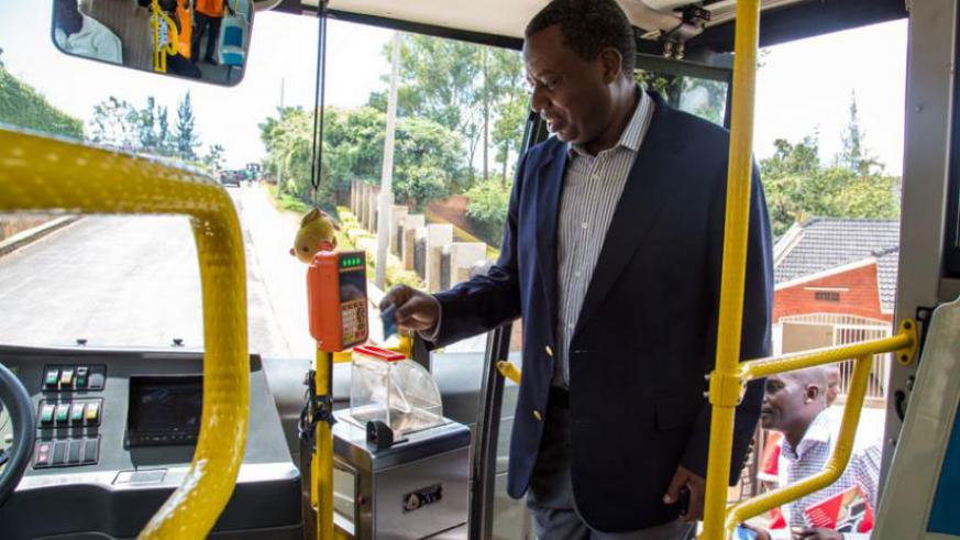 A passenger swipes his Tap & Go card upon boarding a bus.