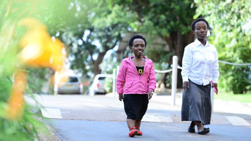 Honorine Tuyishimire (right) takes a walk with a friend.  (Courtesy photo)