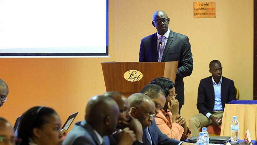 Busingye delivers his remarks during the meeting in Kigali yesterday. T. Kisambira.
