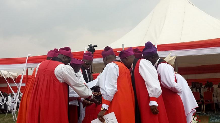 Anglican Bishops pray for-Rev. Musabyimana after his consecration.  Jean d'Amour  Mbonyinshuti.