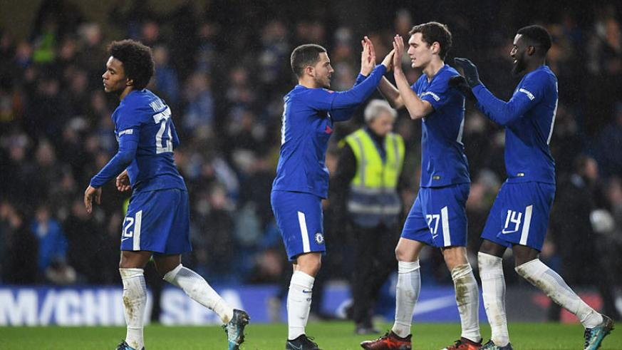 Eden Hazard, who came on as substitute in the first half of extra time, is congratulated by his team-mates following the win. / Net photo