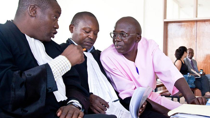 Leo Mugesera (C) talking to his lawyers Otachi Gershom( L)  and Felix Rudakemwa in court April.04.2009. file