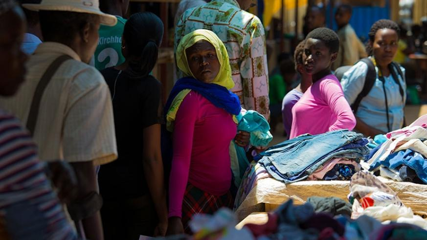 Residents buy secondhand clothes in Gahanga market in Kicukiro District. T. Kisambira
